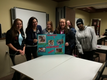 Former CDA Candidates, now CDA Graduates, present a project during a class at CCRN