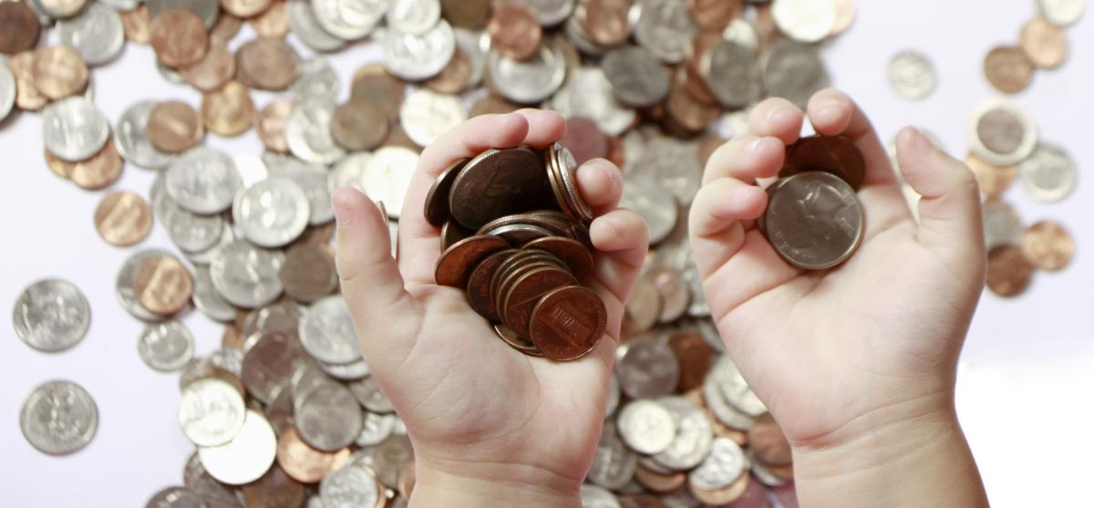 A child holding some coins