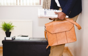 A business-person with a satchel